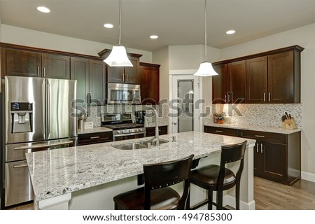 Classic Kitchen Room Interior With Large Kitchen Island With Granite  Counter Tops, Modern Cabinets,