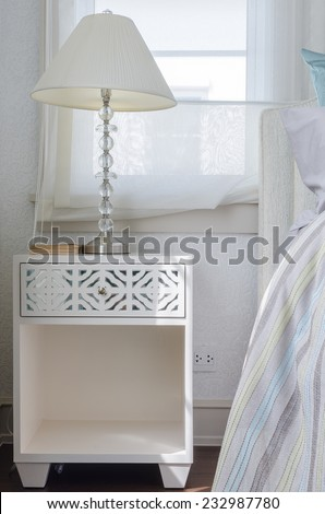 classic lamp on white table in luxury bedroom at home