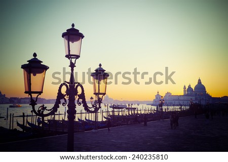classic lamppost in San Marco square at sunset. Shot in Venice, Italy. Processed for vintage tone effect. - stock photo