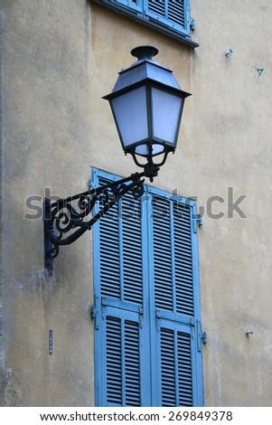 Classic lantern on wall - stock photo
