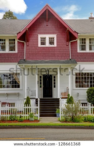 Classic large craftsman old American house exterior in red and white during spring. - stock photo