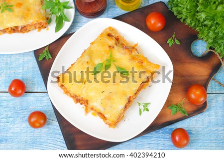 Classic Lasagna with bolognese sauce on a wooden background. Italian food  - stock photo