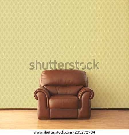 Classic leather armchair in elegant interior with wallpaper - stock photo