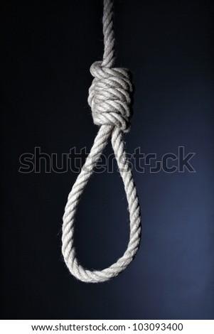 classic loop knot on dark background - stock photo