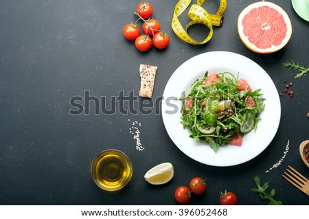 Classic low-calorie diet with salad, boiled eggs and grapefruit. Useful vegetarian food. Place for writing text or recipe. - stock photo
