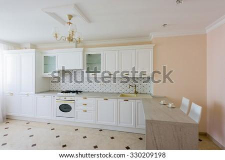 Classic luxurious White Kitchen furniture - stock photo