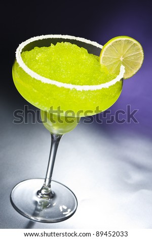 Classic margarita cocktail in front of different colored backgrounds