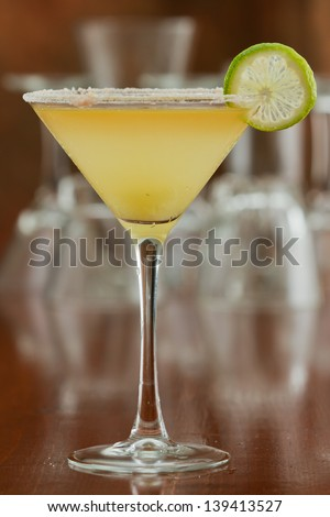 classic margarita served chilled in a martini glass with a float of orange liqueur