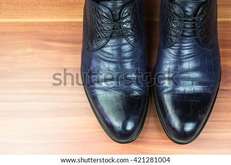 Classic men shoes on wood background  - stock photo