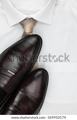 Classic mens shoes, tie on a white shirt, with place for your text.  - stock photo