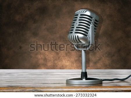Classic Microphone on brown grunge texture - stock photo