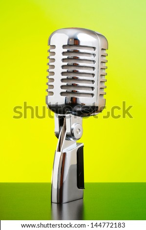 Classic microphone on yellow and green background