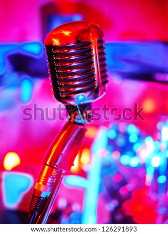 classic microphone with pinkt lighting on background