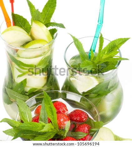 Classic Mojito summer set with apple, lime and strawberry on a white background - stock photo