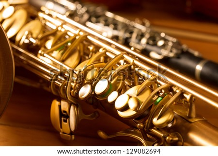Classic music Sax tenor saxophone  and clarinet in vintage wood background - stock photo