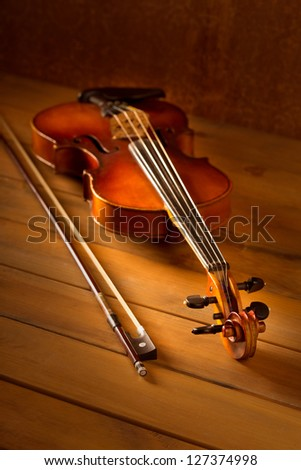 Classic music violin vintage in wooden golden background - stock photo