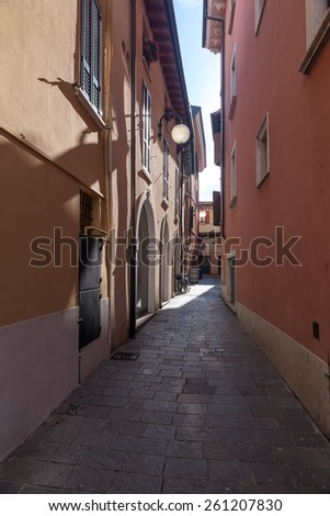 Classic narrow street of the old city in Italy - stock photo