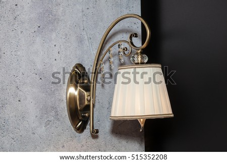 Classic night wall lamp in room interior