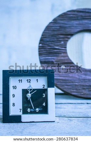 Classic old clock on a wooden floor. - stock photo