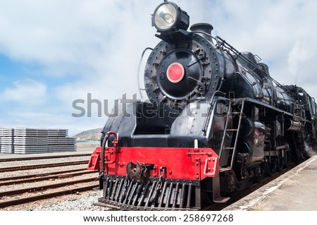 Classic old steam train in the station - stock photo