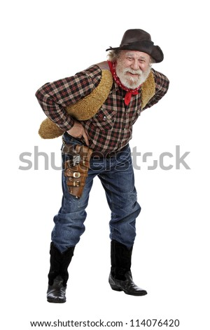 Classic old west smiling cowboy with felt hat, grey whiskers, revolver, stands bending forward. Isolated on white background, copy space, vertical. - stock photo