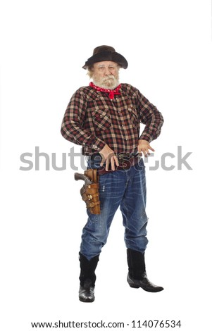 Classic Old West style cowboy with felt hat, grey whiskers, revolver, stands with thumbs hooked into belt.  Isolated on white background, copy space, vertical. - stock photo