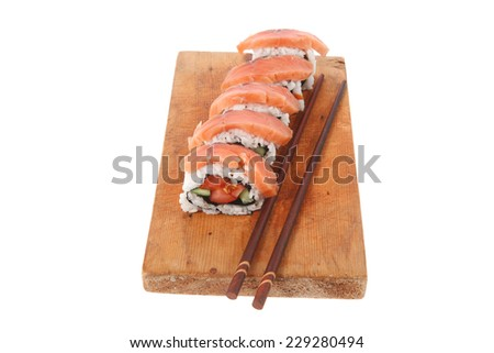 classic onigiri inside out californian sushi rolls with salmon on wooden plate isolated over white background with sticks high resolution hidef - stock photo