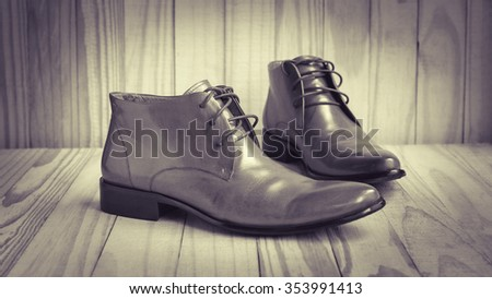 classic oxford shoes on wooden background, sepia tone