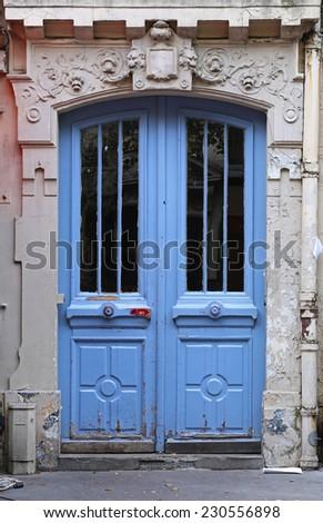 Classic painted wooden door in Paris - stock photo