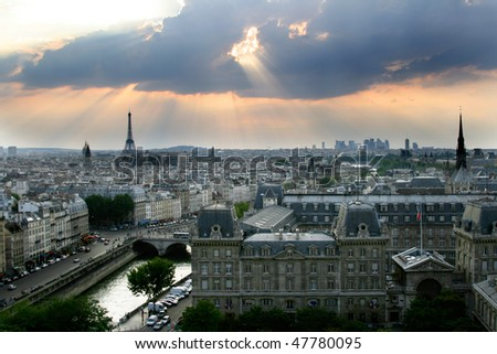 Classic panorama of Paris in France. View of sunset from Notre Dame de Paris. Eiffel tower in the left side. Historic buildings in a front on island de la Cite. - stock photo