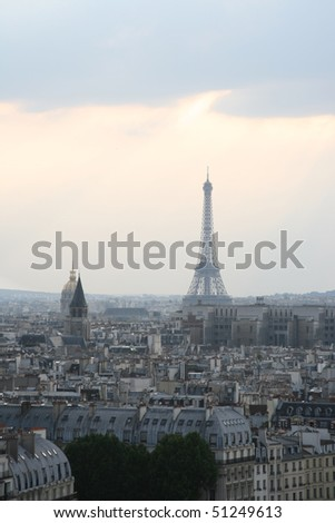 Classic panorama of Paris in France. View of sunset from Notre Dame de Paris. Eiffel tower in the right side. Skyscrapers and office buildings in a background. - stock photo