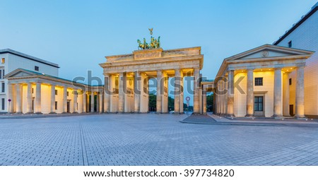 Classic panoramic view of famous Brandenburger Tor (Brandenburg Gate), one of the best-known landmarks and national symbols of Germany, in twilight during blue hour at dawn, Berlin, Germany - stock photo
