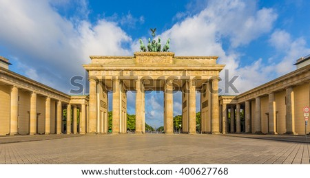 Classic panoramic view of famous Brandenburger Tor (Brandenburg Gate), one of the best-known landmarks and national symbols of Germany, in beautiful golden morning light at sunrise, Berlin, Germany - stock photo