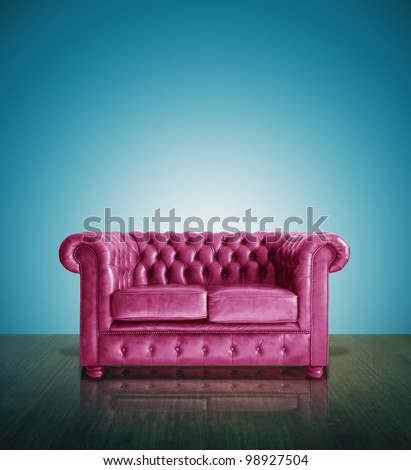 Classic pink leather sofa and  blue background. - stock photo