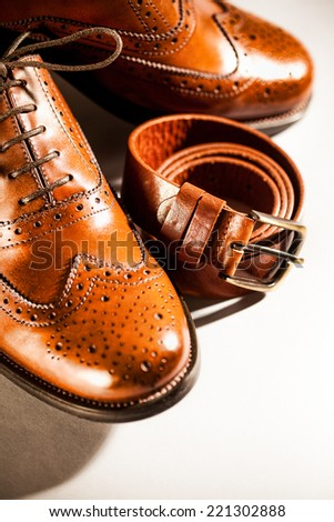 Classic polished men's oxford brogues and brown belt.