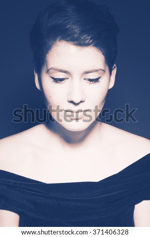 Classic portrait of a beautiful young woman. - stock photo