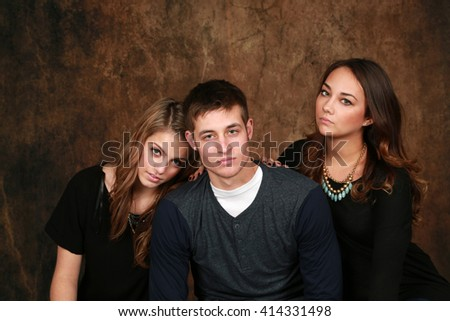 classic portrait of three very attractive teens