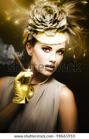 Classic Portrait Of Vintage Cinema With A Well Dress Female Actor Wearing Classy Retro Fashion While Holding A Smoking Cigar During A Onscreen Film Shoot - stock photo