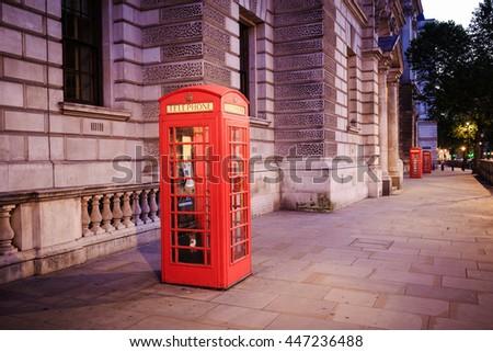 Classic red British telephone box in London. - stock photo