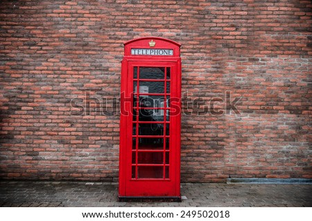 Classic red British telephone box in UK - stock photo