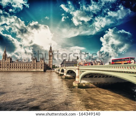 Classic Red Double Decker Buses crossing Westminster Bridge to the Houses of Parliament - London. - stock photo