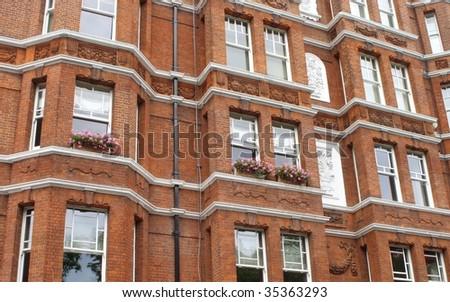 Classic red stylish apartment block. - stock photo