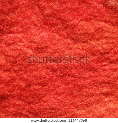 classic red wool felt background, traditional natural ecological handmade fabric sample - stock photo