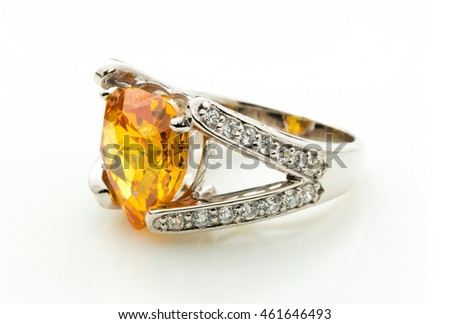 classic ring with a yellow/orange topaz stone on white background