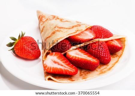 Classic russian pancake with fresh strawberry - stock photo