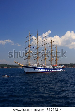 classic sailboat on the Adriatic sea with cloudy background