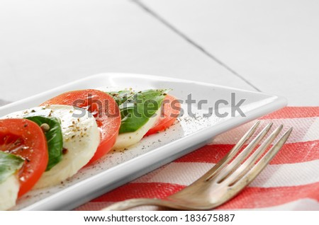 Classic salad caprese on white plate