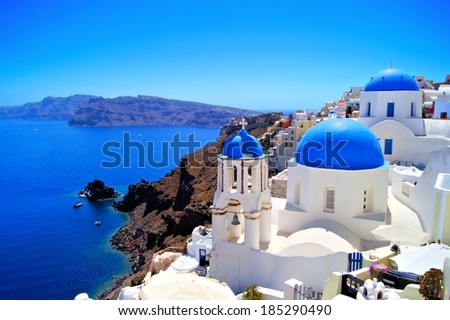 Classic Santorini scene with famous blue dome churches, Greece - stock photo