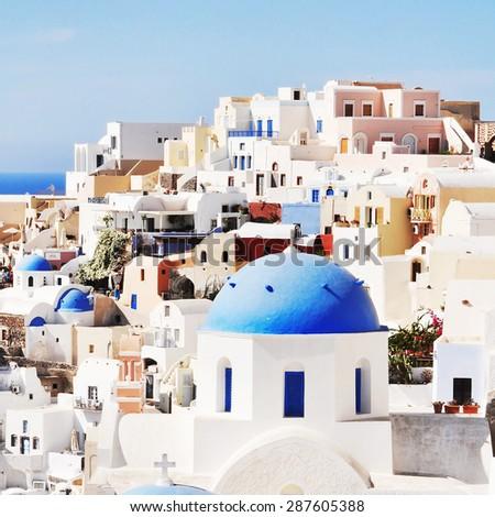 Classic Santorini scene with famous blue dome churches, Greece - stock photo