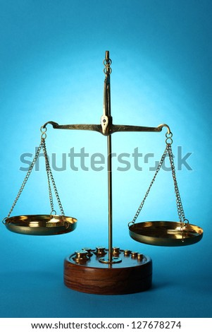 Classic scales on blue background - stock photo